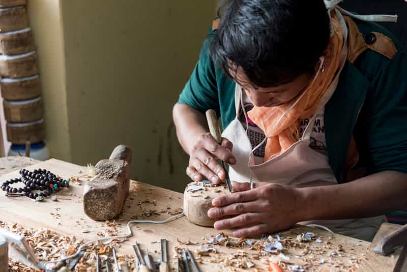 Tibetan artisans working their traditional trades are a common sight at the Norbulingka Institute