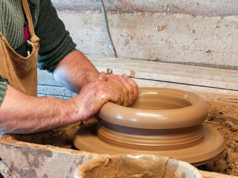 Traveler learning Pottery