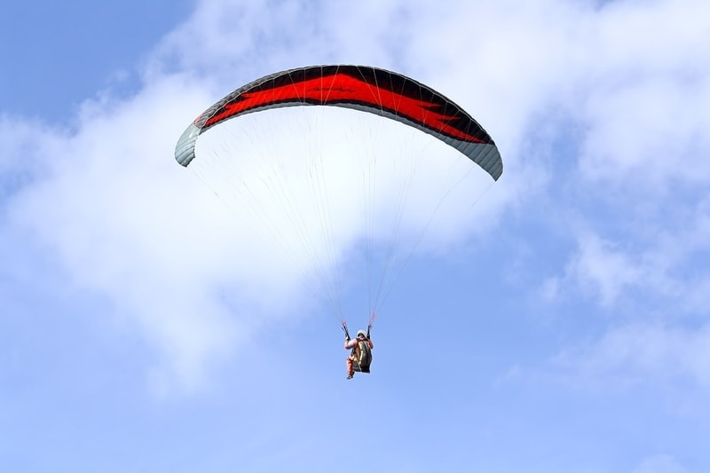 A tourist enjoying paragliding at Kamshet