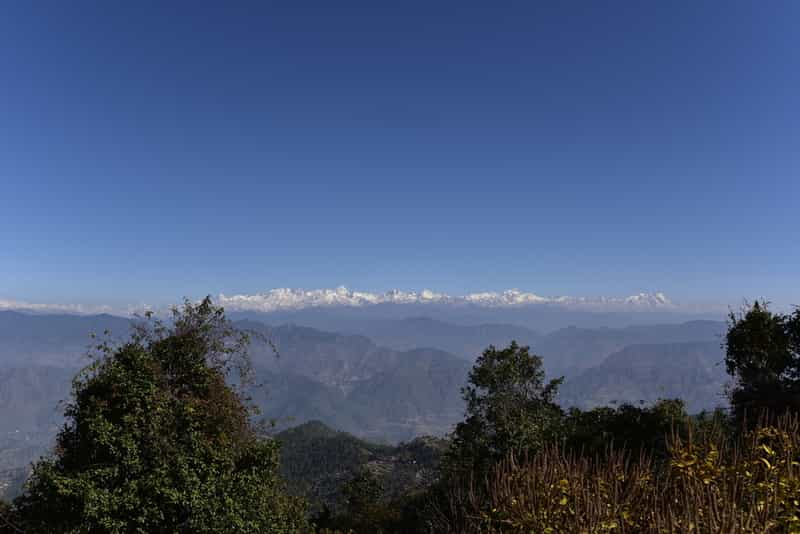 Enjoy stunning views of the snow clad Himalayas from Kanatal
