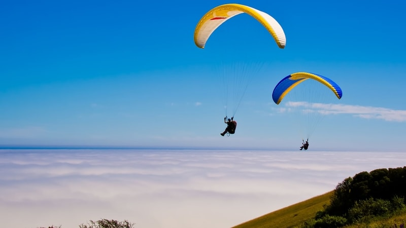 Tourists enjoying paragliding at Kamshet