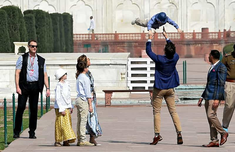 Justin Trudeau playing with his son at the Taj Mahal