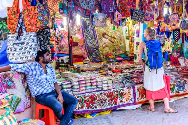 A tourist looking to buy at the Haat