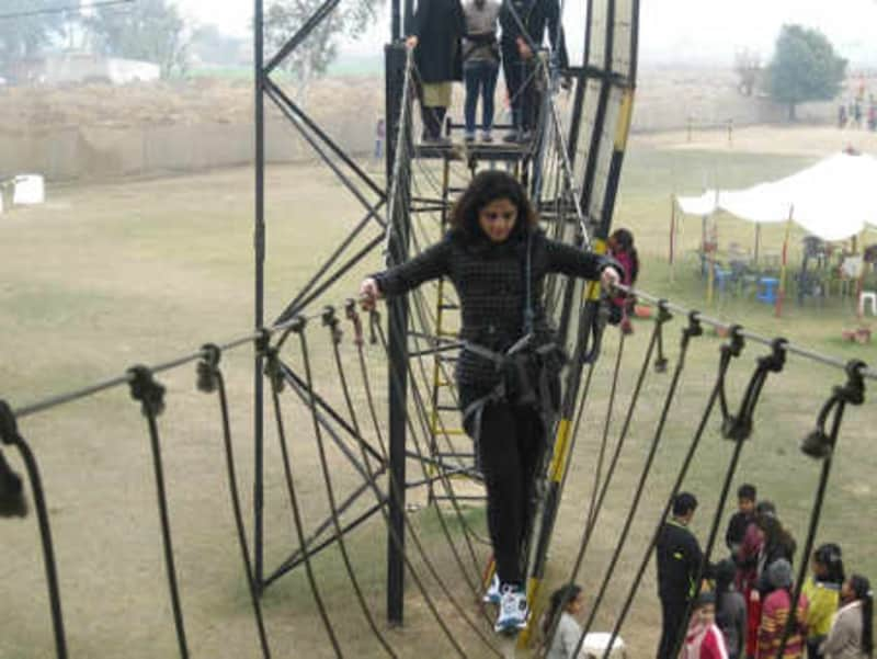 A visitor tries one of the obstacle courses at the park