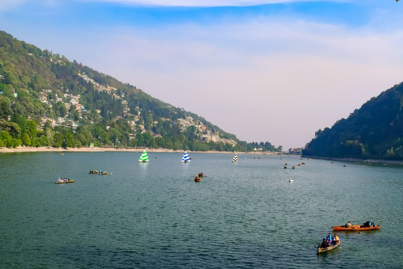 Enjoy scenic views of the hills from the Nainital Lake
