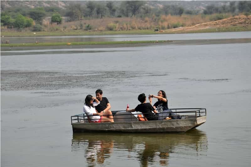Tourists enjoying a boat ride at the Damdama Lake