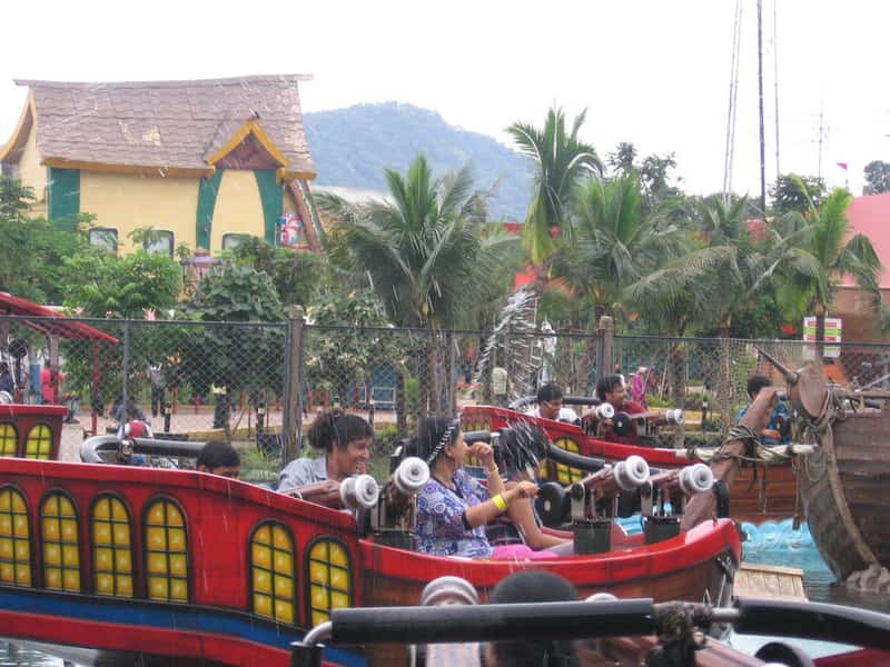 Visitors enjoying themselves on one of the rides