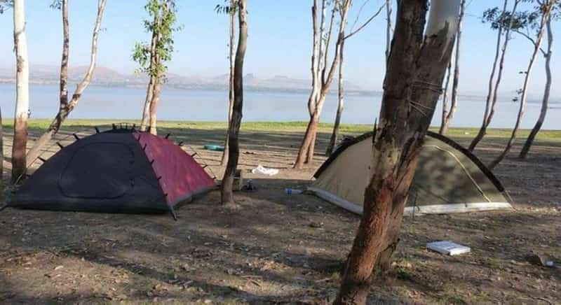 A tent camp set up by the Mukne lake