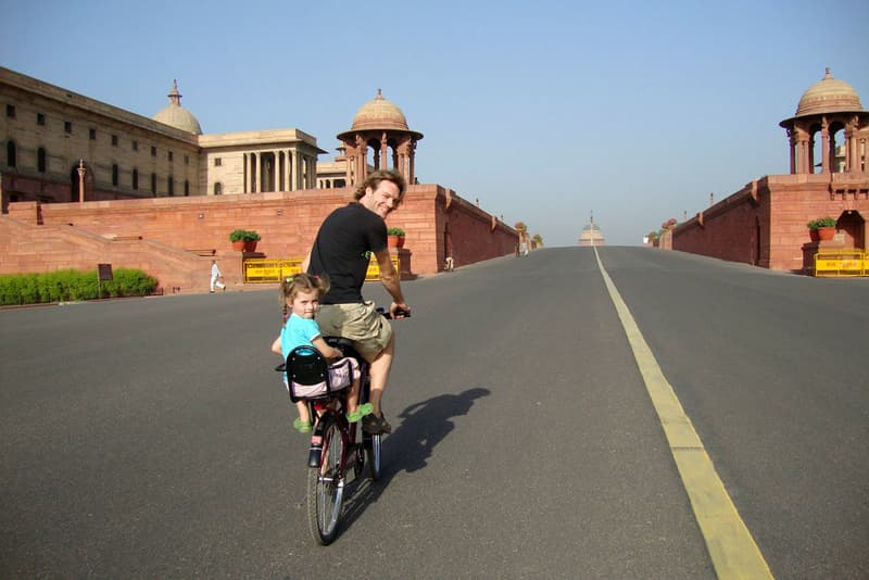 A tourist taking a cycling tour of Delhi