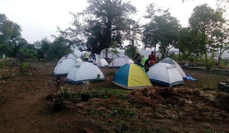 Enjoy camping in a forest at Tikona.