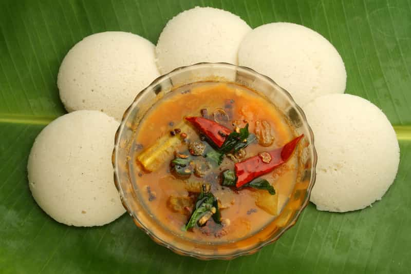 Idli served on a banana leaf