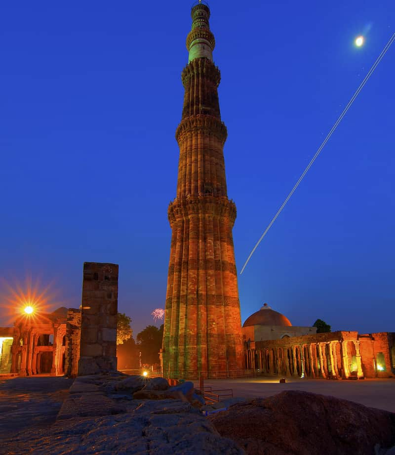The massive monolith of Qutub Minar at night