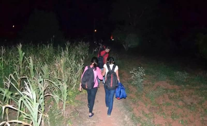 Trekkers going through a field in Ramanagara