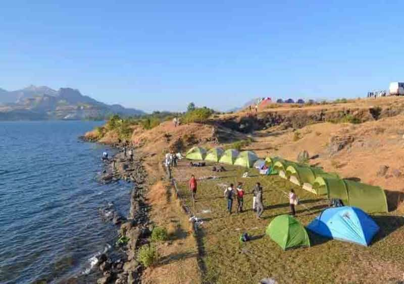 Visitors camping by the Bhandardara Lake camp