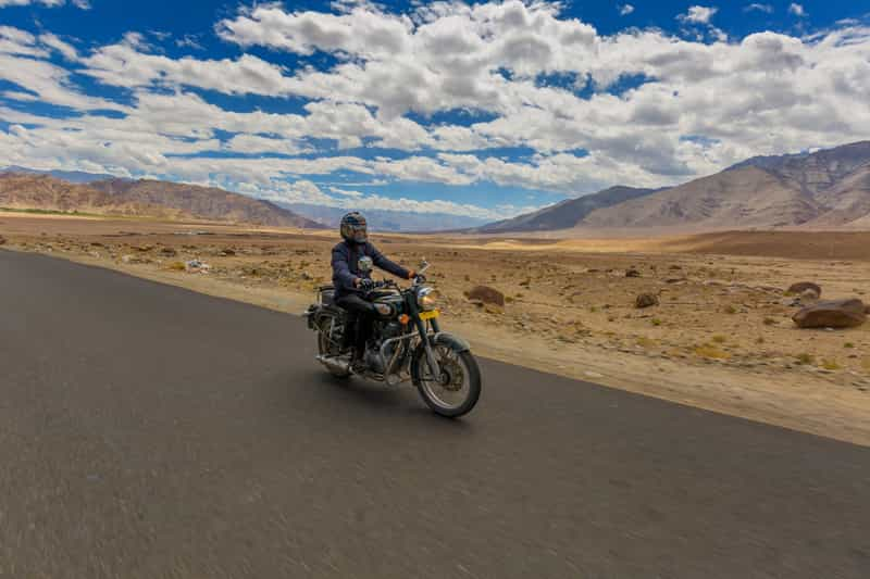 A biker enjoying cruising on his way back to Srinagar from Leh