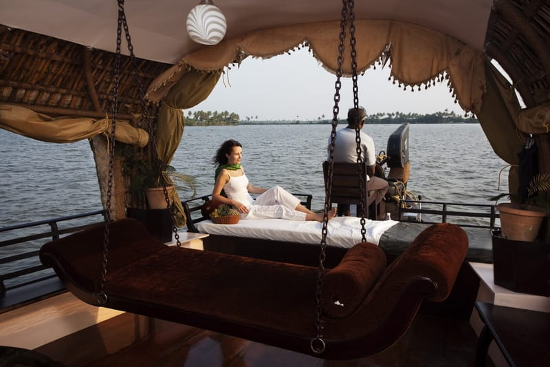 Relax and soak in the lovely surroundings on a houseboat in Alleppey